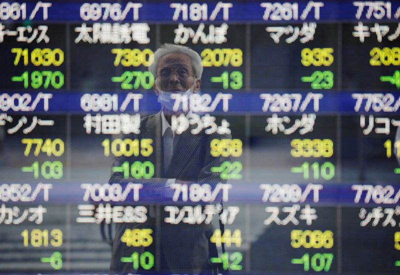 Stocks cling to weekly gains despite Evergrande hit and bond yield jump